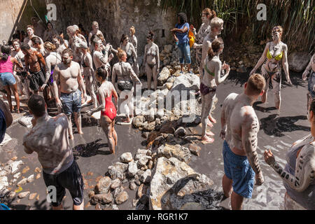 Tourists enjoying the Sulphur Springs, volcanic mud baths, Soufriere, Saint Lucia. - Stock Image