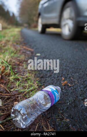 Plastic bottle littering roadside, Northumberland national park, Northumberland, UK - Stock Image