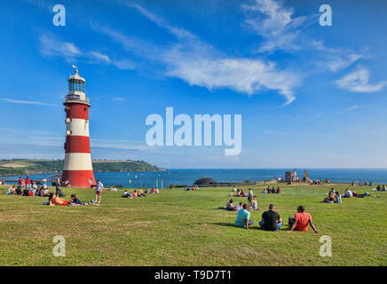 9 June 2018: Plymouth, Devon UK - Plymouth Hoe on a beautiful spring evening, with the third Eddystone Lighthouse, now known as Smeaton's Tower, reloc - Stock Image