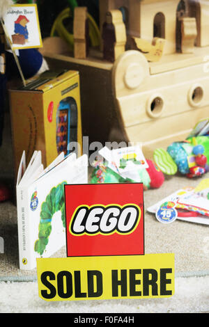 Lego sold here sign in a toy shop window. - Stock Image