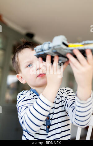Boy playing with lego - Stock Image