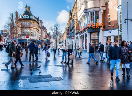 Shoppers in Leicester city centre. - Stock Image
