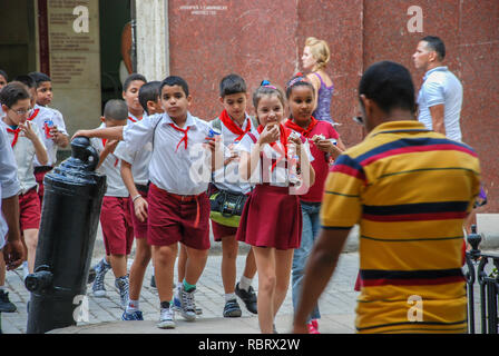 Cuba, Havana, the students are the pioneers walking down the street after school and drinking coke - Stock Image