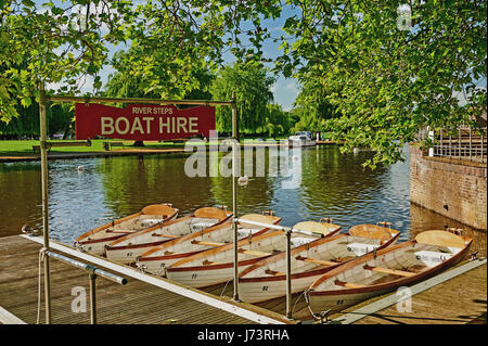 White rowing boats moored on the River Avon in Stratford upon Avon, Warwickshire. - Stock Image