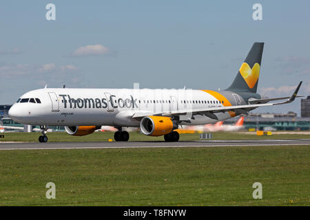 Thomas Cook Airlines Airbus A321-200, registration G-TCDJ, preparing for take off at Manchester Airport, England. - Stock Image