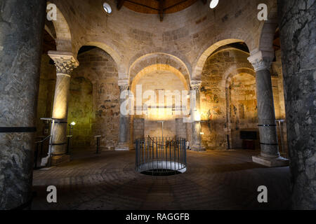 Interior of the Church of San Giovanni al Sepolcro in the city of Brindisi, Italy, showing marble and granite columns and medieval wall frescoes - Stock Image