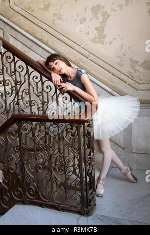 Cuba, Havana. Ballerina posing by antique staircase. Credit as: Wendy Kaveney / Jaynes Gallery / DanitaDelimont.com - Stock Image