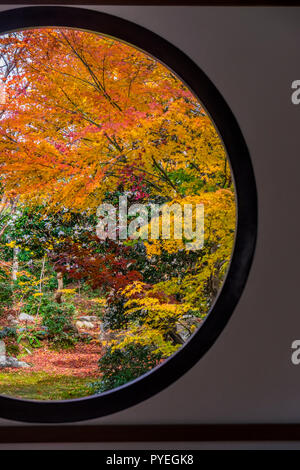 Famous Genko-an Temple with window of enlightenment and window of illusion at autumn day, Kyoto, Kansai, Japan - Stock Image