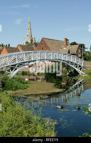 White painted Chinese bridge at Godmanchester over river with church church steeple 2005 - Stock Image