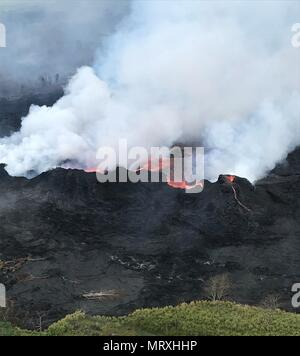 Lava and poisonous sulfur dioxide plumes rise as molten magma spews from fissure 22 from the eruption of the Kilauea volcano May 26, 2018 in Pahoa, Hawaii. - Stock Image