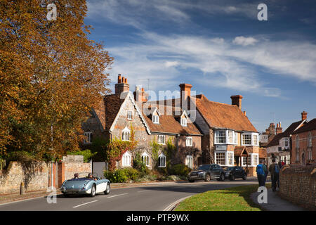 England, Berkshire, Goring on Thames, High Street, Austin Healey car approaching Miller of Mansfield pub and Gothic house on bend in main road - Stock Image