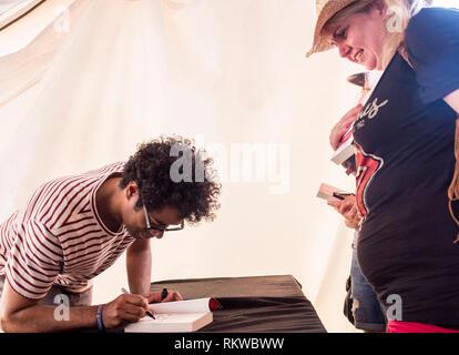 Richard Ayoade signing books at Latitude Festival 2018. - Stock Image