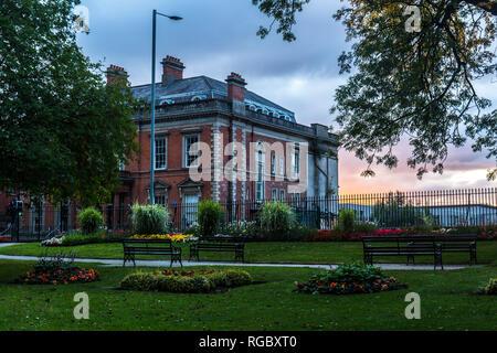 View from Castle Gardens towards building on Castle Street, Lisburn, N.Ireland. - Stock Image