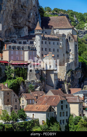 Rocamadour in the Lot department of southwestern France. Rocamadour has attracted visitors for its setting in a gorge above a tributary of the River D - Stock Image