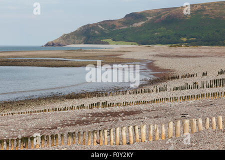 Beach between Porlock and Porlock Weir, Bossington Hill in background - Stock Image