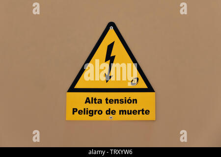 High Tension electric power sign, black lightning arrow on a yellow triangle - Stock Image