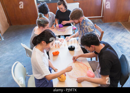 People enjoying string art craft - Stock Image