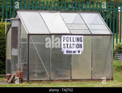 Polling station sign on greenhouse. UK - Stock Image