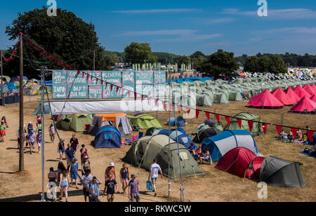A view of the camping area of the Latitude festival 2018 with Henham Park trees and fields all around taken from one of the security watch towers. - Stock Image