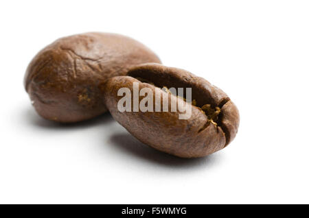 Coffee beans on a white background. - Stock Image