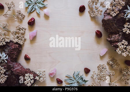 Native Flowers and Sage with Red Jasper and Rose Quartz with Space for Copy - Stock Image