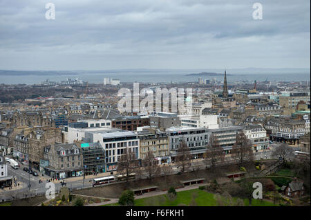 View from Castle Hill across West Princes Street Gardens and the bus busy Princes Street with its colourful shop - Stock Image