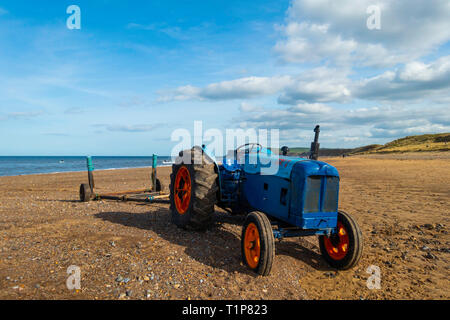 Beach at Marske by the Sea North Yorkshire a fisherman's tractor parked while the boat is at sea. - Stock Image