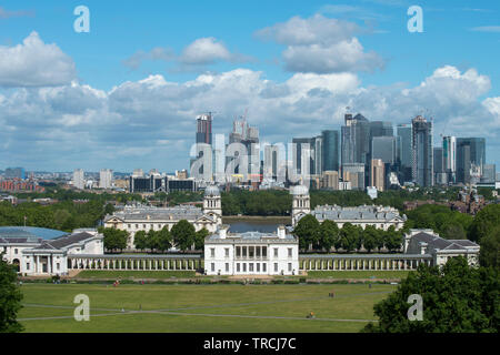London England UK. Canary Wharf and Queen's House Greenwich photographed from Greenwich Park in South East London. May 2019 - Stock Image