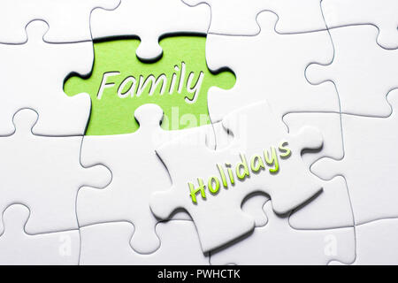 The Words Holidays And Family In Missing Piece Jigsaw Puzzle - Stock Image