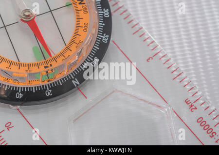 Macro-photo of compass rose face with needle - with copy space. North direction. Outward Bound concept. - Stock Image