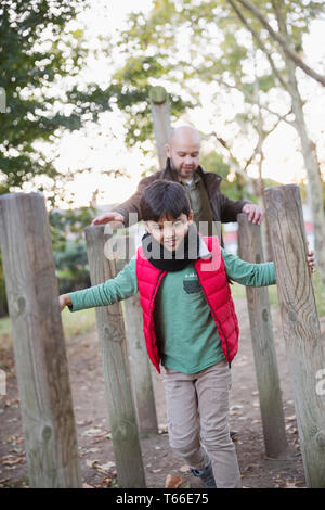 Father and son playing in park - Stock Image