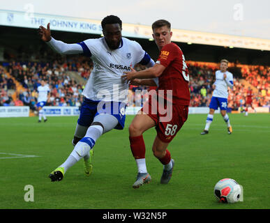 Prenton Park, Birkenhead, Wirral, UK. 11th July 2019. Pre-season friendly football, Tranmere versus Liverpool; Emmanuel Monthe of Tranmere Rovers and Ben Woodburn of Liverpool compete for the ball Credit: Action Plus Sports Images/Alamy Live News - Stock Image