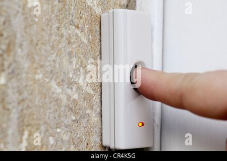 Pressing doorbell - Stock Image