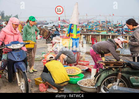 Vietnam early morning fish market at a busy fishing port. - Stock Image