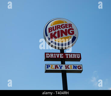 BurgerKing sign with a clear blue sky behind in The Azores - Stock Image