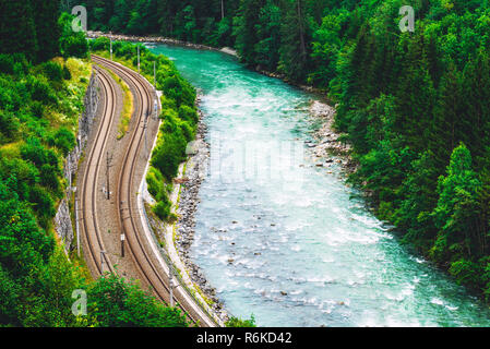 Aerial view of railway track through the forest - Stock Image