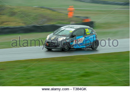 Dunfermline, Scotland, UK. 7th April, 2019.    24 Kyle Grant exits McIntyre's during a Scottish Citroen C1 Cup race at Knockhill Circuit. During a wet and misty opening round of the Scottish Championship Car Racing season organised by the SMRC (Scottish Motor Racing Club) at Knockhill. Credit: Roger Gaisford/Alamy Live News - Stock Image