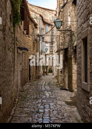 Cobbled stone narrow street, Trogir, Croatia - Stock Image