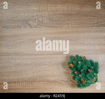 Christmas tree on brown wooden texture background - Stock Image