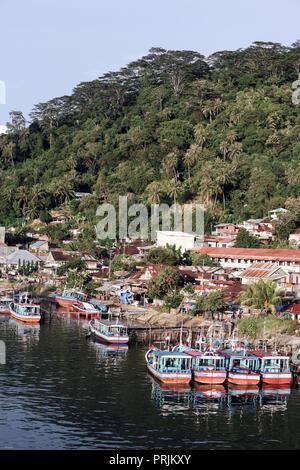 Fishing boats moored at river port in Padang, Sumatra, Indonesia - Stock Image