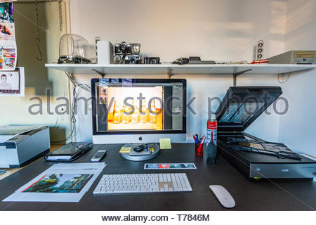 Tilburg, Netherlands. Workplace at home of a highly skilled image professional, scanning analog photo film into digital image files. - Stock Image