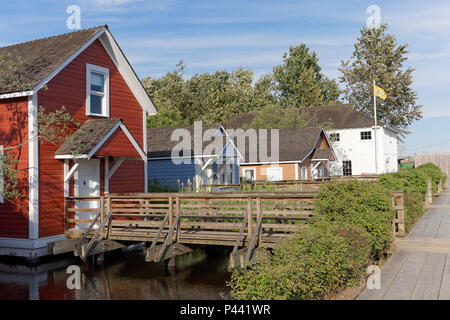 Restored wooden stilt houses and Chinese Bunkhouse  in the Britannia Heritage Shipyard park, Steveston,  Richmond, British Columbia, Canada - Stock Image