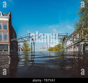 Digital manipulation of flooded town in Netherlands - Climate Change concept. - Stock Image