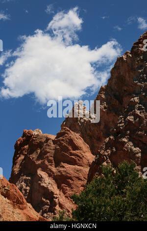 Climber hikers Garden of the Gods Park Colorado Rocky Mountain - Stock Image