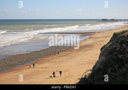 A view of the beach looking eastwards from the cliff top at the North Norfolk village of East Runton, Norfolk, England, United Kingdom, Europe. - Stock Image