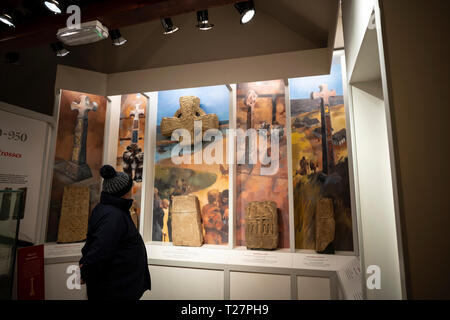Lindisfarne or Holy Island, Northumberland coast south of Berwick-on-Tweed, England. In the visitor centre museum. Exhibit about crosses. - Stock Image