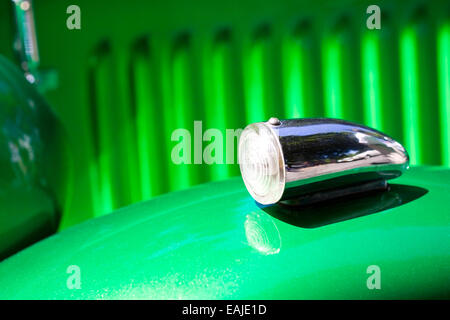 Closeup on turn signal of old shiny vintage car - Stock Image