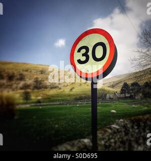 Speed limit road sign in the Yorkshire Dales near Buckden - Stock Image