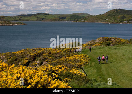 hikers on coastal path to Rockliffe & Kippford, Rough Firth, Dumfries & Galloway, Scotland - Stock Image