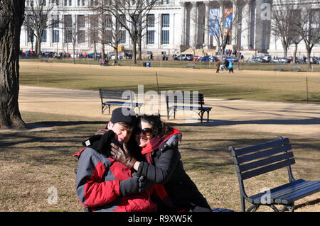 Woman with Autistic Son Seated on Bench at the National Mall near the National Gallery of Art, Washington DC - Stock Image